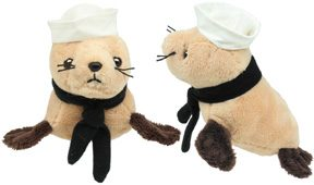 cute seal plush with navy hat and ascot